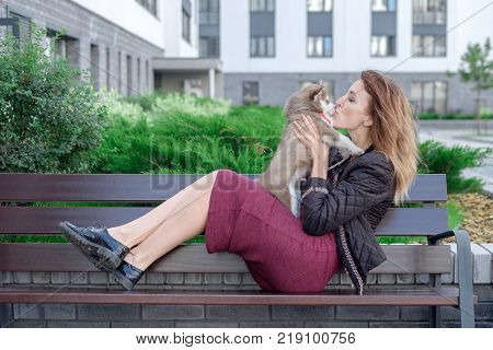 Young women holds her best friend little pet puppy of husky in her arms. love for dogs.