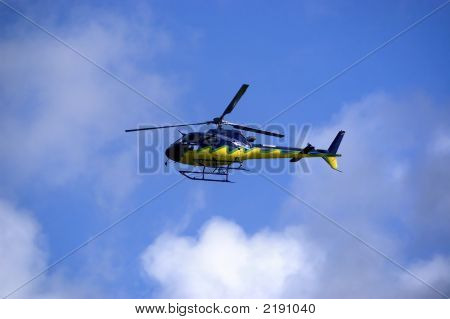 Yellow-Blue Helicoper In The Sky