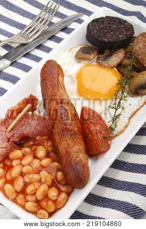 british full breakfast on a white plate