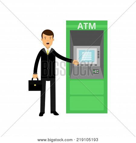 Cheerful businessman standing next to ATM terminal with briefcase in hand. Client of bank. Cartoon male character wearing official black suit. Flat vector illustration isolated on white background.