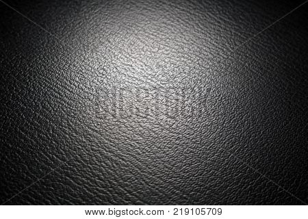 Black leatherette texture. Abstract black background. Texture.