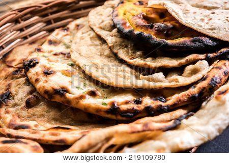 Assorted Indian Bread Basket includes chapati, tandoori roti or naan, paratha, kulcha, fulka, missi roti