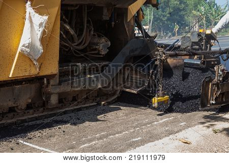 an asphalt machine in close up for the renewal of the asphalt