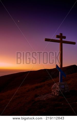 Cross on Mount Big Thach at sunrise