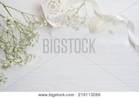 Mock up Composition of white flowers rustic style, hearts and a gift for St. Valentine's Day with a place for your text. Flat lay, top view photo mock up.