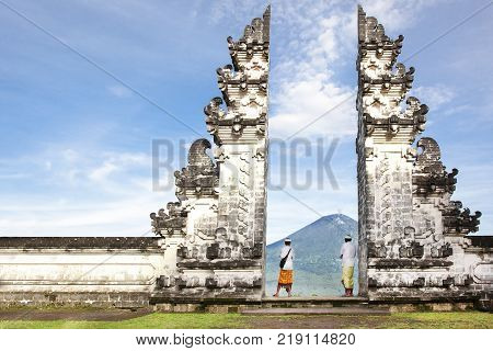 balinese people standing betwen Lempuyang gate. Bali