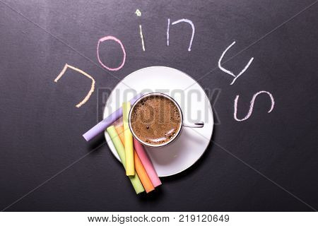 The picture with words join us can be used for jobs hiring . A cup of coffee and colored chalk are symbols of creative work in a team