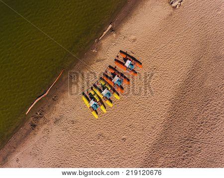 Panorama aerial view on the beach, catamarans, water bicycle, water bike