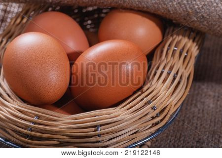Easter composition. A few eggs in a beautiful basket from willow closeup