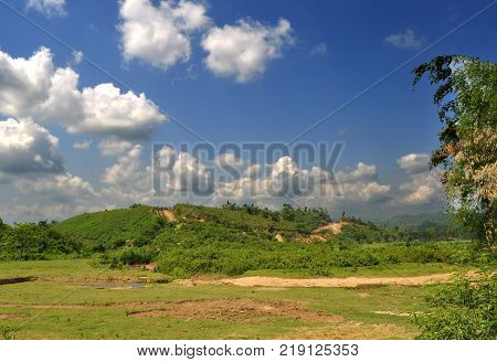 Beautiful summer landscape with low land hilly land and blue sky with fluffy clouds