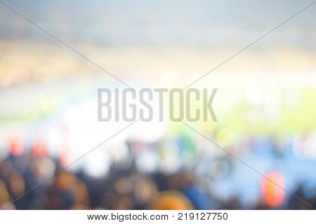 Blur image of cheers in the stadium with bokeh for background usage.