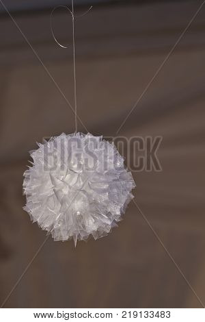 ball of white tulle hanging from a thread