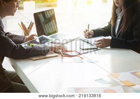 Business consulting conceptPeople meeting and planning adviser analyzing financial figures denoting the progress in the work.