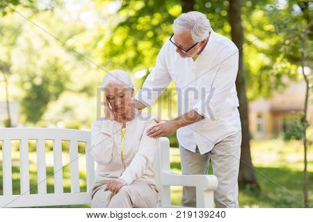 health, stress, old age and people concept - senior woman suffering from headache outdoors