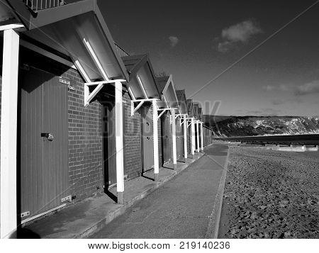 Swansea Beach huts black and white Swansea beach huts England - November 22, 2017: View of Swansea beach huts