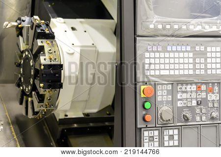 Close up of the CNC lathe panel .CNC lathe or CNC turning machine. Hi-precision CNC machining concept.