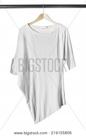 White casual oversized blouse on wooden clothes rack isolated over white