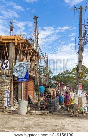 POKHARA NEPAL - October 2 2013: Construction of a building in Pokhara. Pokhara is the starting point for most of the treks in the Annapurna area.