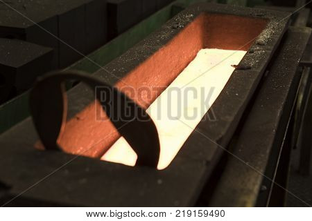 Molten metal Iron Casting in metal mold ; close up