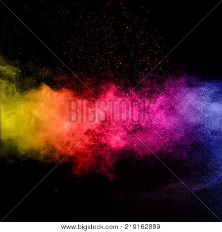 abstract color powder explosion on black background.abstract Freeze motion of color powder splash.