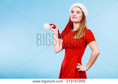 Xmas seasonal clothing winter christmas concept. Happy woman wearing Santa Claus helper costume