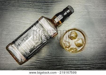 Niedomice Poland - December 20 2017: A glass of Jack Daniel's Tennessee Whiskey with ice. View from above.