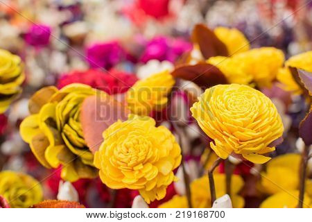 paper made artificial colored flowers handicrafts on display in Handicraft Fair in Kolkata - the biggest handicrafts fair in Asia.