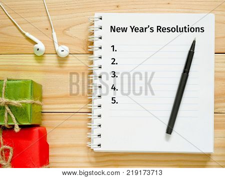 Notebook and pen for writing New Year's Resolutions. New Year Goals concept.