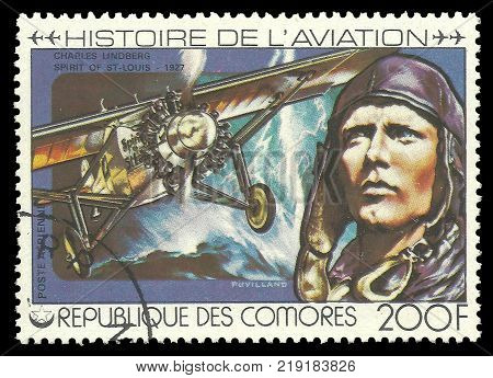 Comoros - CIRCA 1978 - stamp printed by Comoros Multicolor memorable Edition offset printing on Topic of Aviation History, Shows Charles Lindberg and airplane 1927