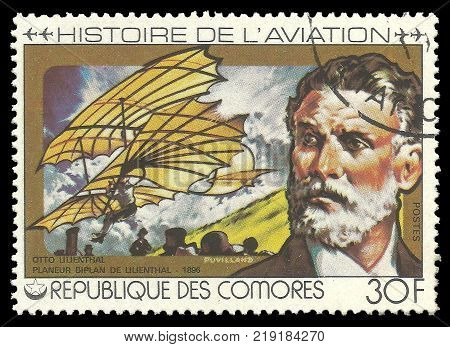 Kiev, Ukraine, December 22, 2017 - CIRCA 1978: stamp printed by Comoros Color memorable offset  Edition on Topic of Aviation History Shows Otto Lilienthal 1896 and airplane