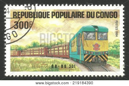 Kiev, Ukraine, December 22, 2017: Stamp printed by Congo Color memorable edition offset printing on topic of Railway shows cargo train with Locomotive, CIRCA 1984