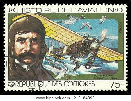 Kiev, Ukraine, December 22, 2017: stamp printed by Comoros Color memorable Edition offset printing devoted Aviation History Shows Louis Bleriot 1909 and airplane, CIRCA 1978