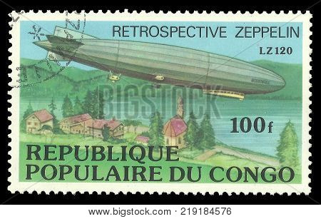 Congo - CIRCA 1977: stamp printed by Congo Color memorable edition offset printing on Topic Retrospective of Aviation Shows aircraft Zeppelin over the river