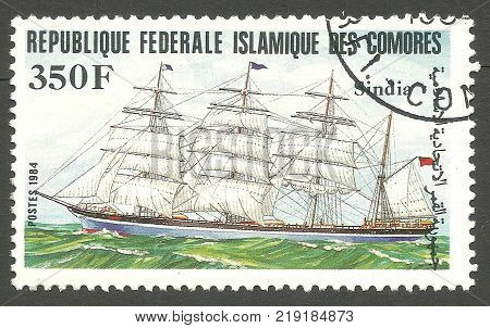Comoros - CIRCA 1984: stamp printed by Comoros Color memorable Edition offset printing Shows Sailing ship Sindia  in the roadstead