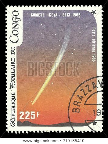 Congo - CIRCA 1986: Stamp printed by Congo Color memorable Air mail edition offset printing devoted Halley's Comet shows Comet Ikeya-Seki in the Sky