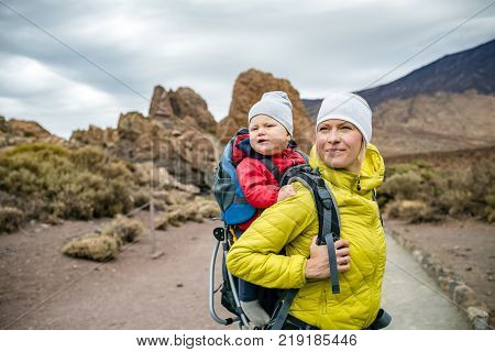 Super Mother Hiking With Toddler In Backpack