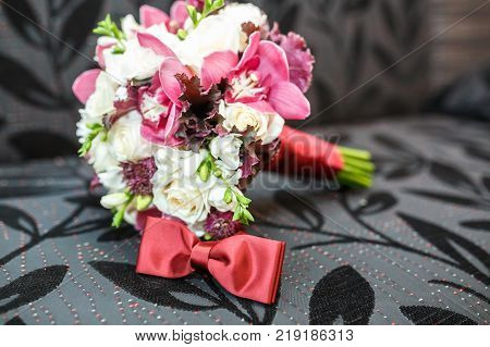 bridal bouquet of white and pink peonies and roses with tie bow