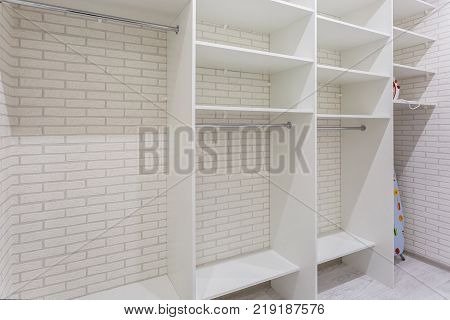 empty cabinets in the pantry white shelves