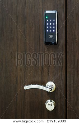 wooden closed door with electronic combination lock