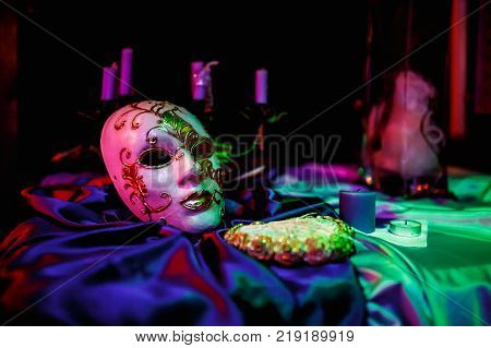 White tone Venecian carnival Mask on table with black background