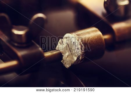 Jewelry works with diamond close-up. Diamond cut is close-up. Making jewelry from precious stones. Machine for sharpening diamonds