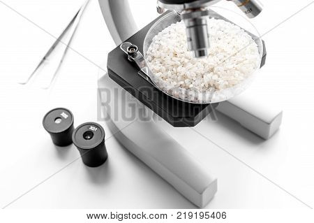 Food analysis. Rice under the microscope on white background.