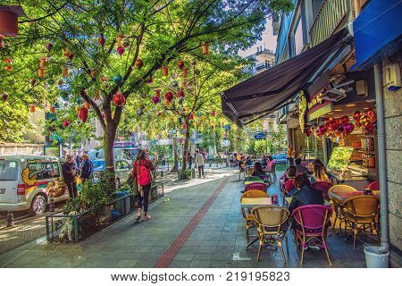 ISTANBUL, TURKEY - October 12, 2017: Famous street cafe of ice cream in Kadikoy district and a lot of people arownd