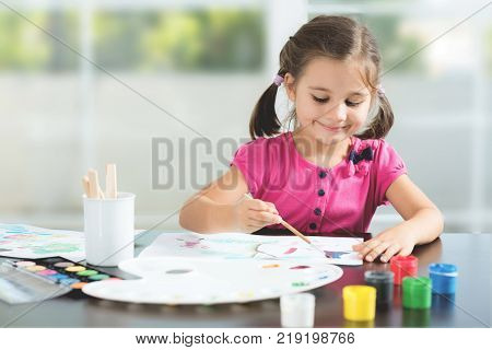 Little Girl Painting Picture At Home or in Kindergarten