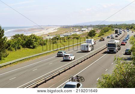 Colwyn Bay Wales United Kingdom - June 22 2014 : The busy A55 main road in Colwyn Bay North Wales