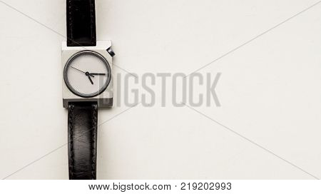 .A wrist watch with black straps on a white background