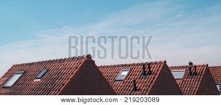 Old dutch house roofs on a sunny day with a clear blue sky, The Netherlands