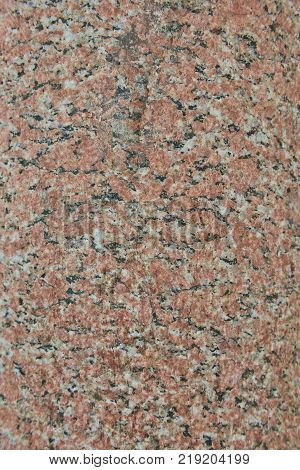 Facing material red granite texture. Natural stone granite background texture. Bright hard red granitic rock texture. Red granite granitic stone background texture. Red granite untreated surface.