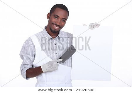 Chef with a cleaver and a white board ready for text