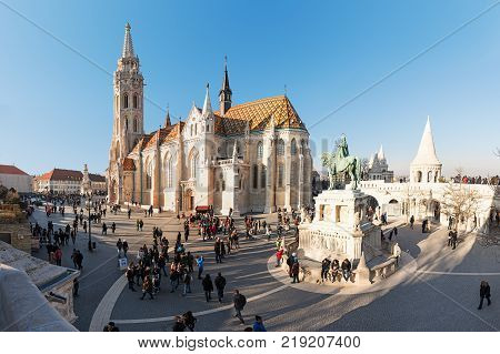 Budapest Hungary - December 30 2016: King St Stephen equestrian Statue by sculptor Alajas Strobl and Matthias church (Matyas templom) at Fisherman Bastion Castle Hill (Varhegy) Buda Budapest